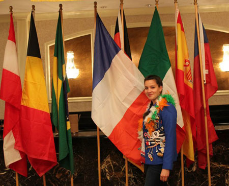 Inbound Rotary YEX Student with Flags at 2012 District Conference